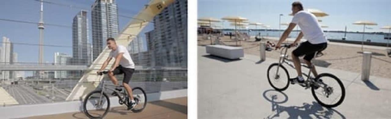 「HELIX」は折り畳みでありながら、自然なライディングポジションが取れる自転車  左に写っているのは「スカイツリー」…ではなく、CNタワーです