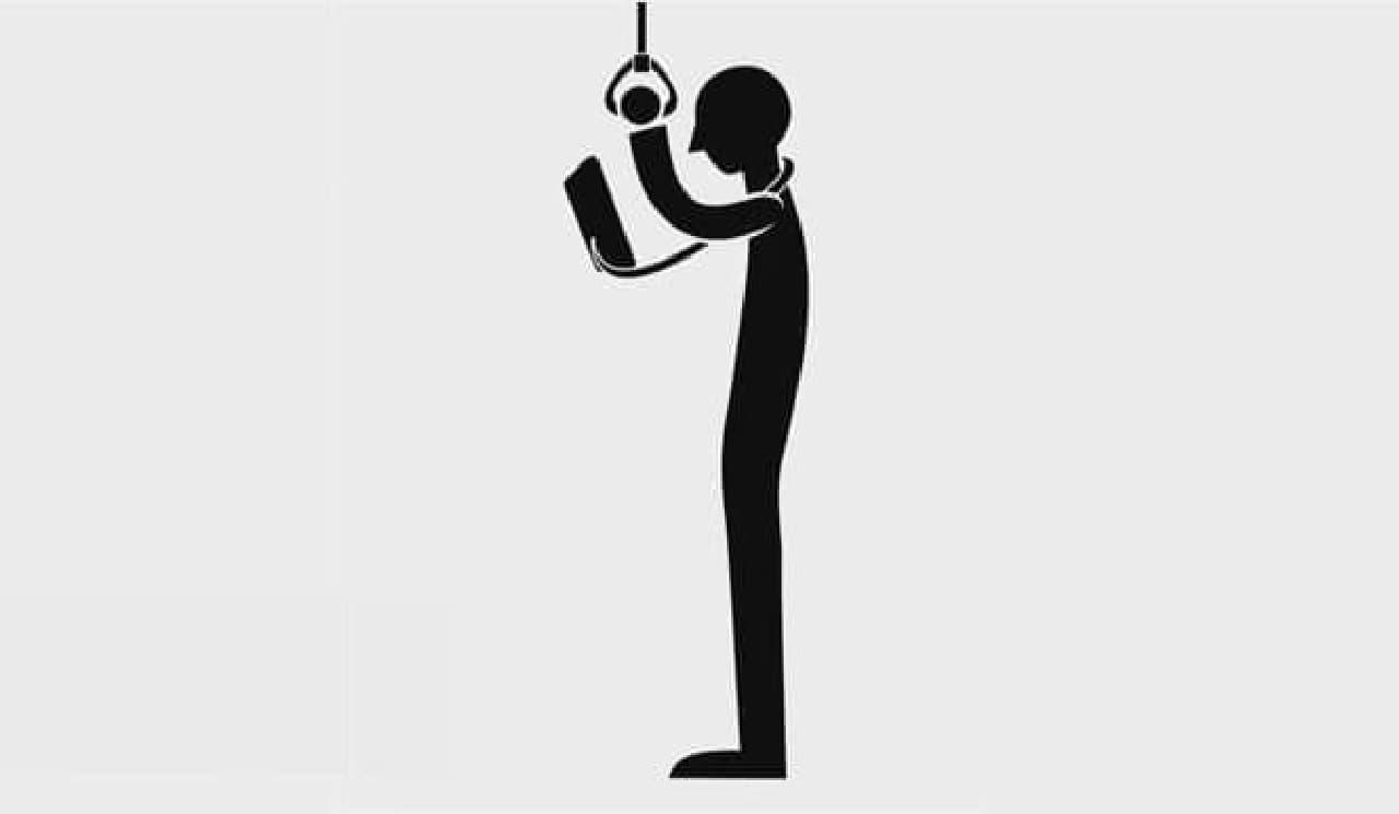 つり革につかまっているとき、  「SOSPENDO」でスマートフォンを保持すれば、  両手操作が可能になる