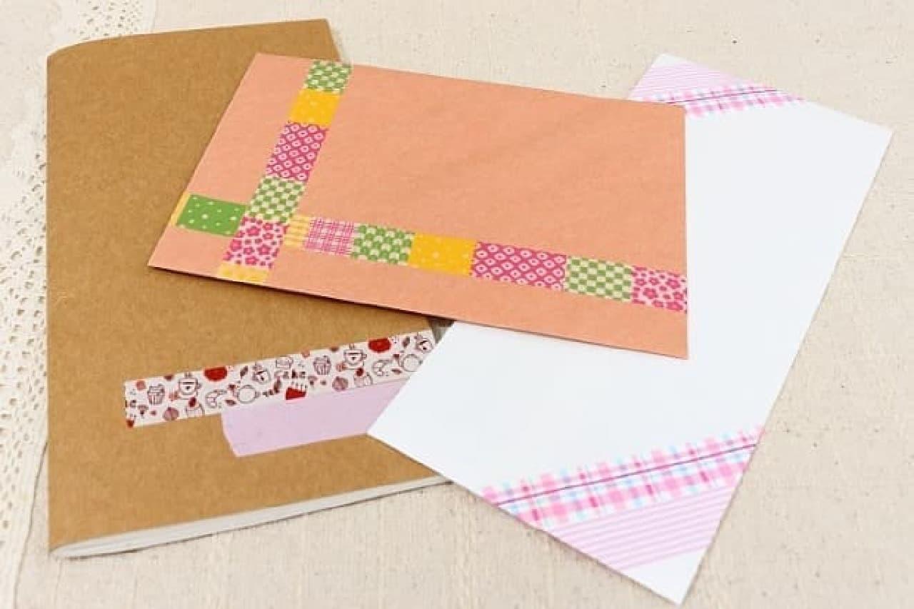 マスキングテープでデコレーションした封筒とノート