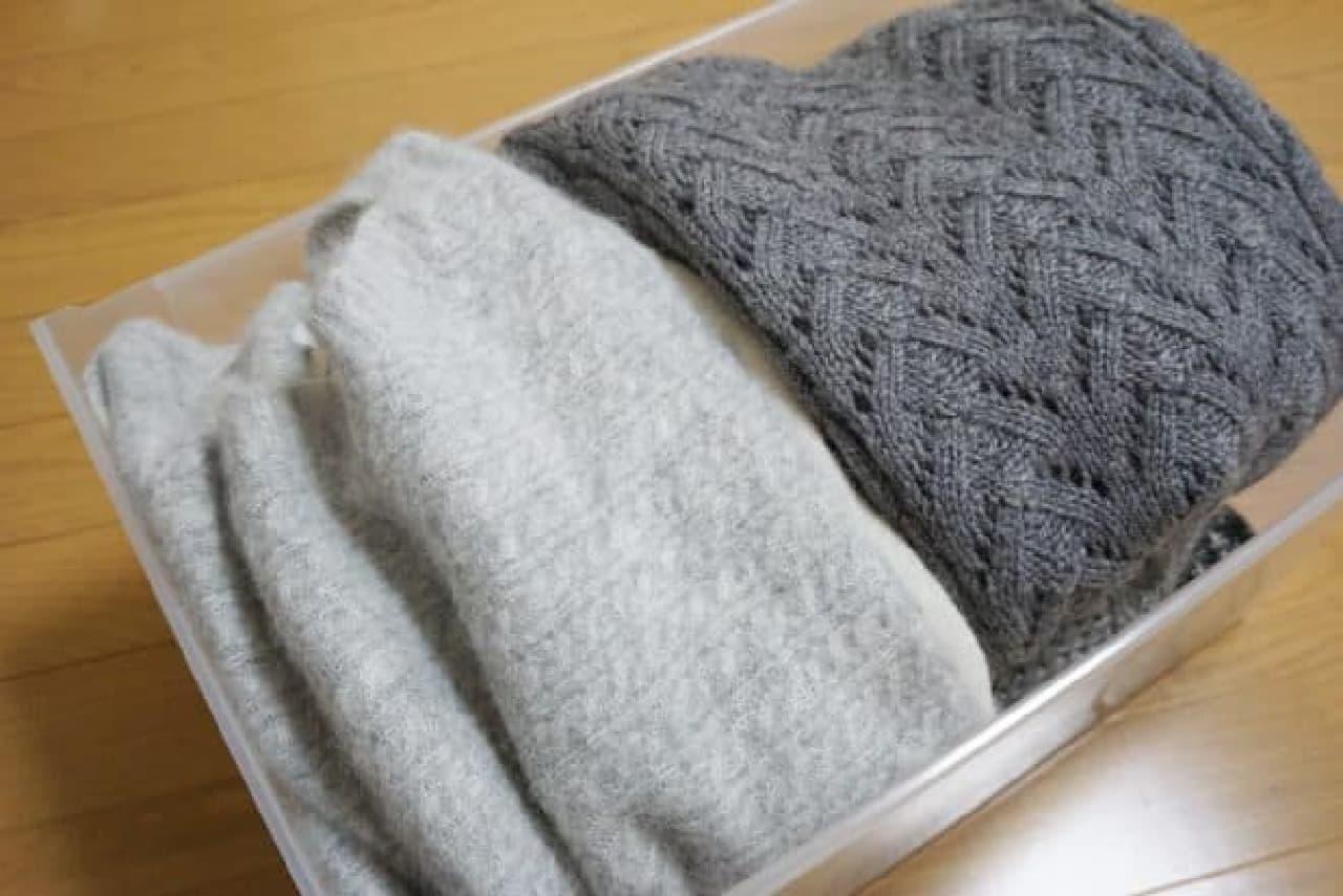 詰め込まれたセーター