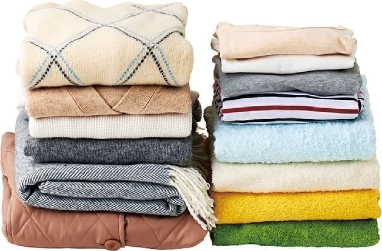 使わない布団がクッションになる「防ダニシート付おふとん変身収納袋」 -- 衣替えの衣服やタオル類にも