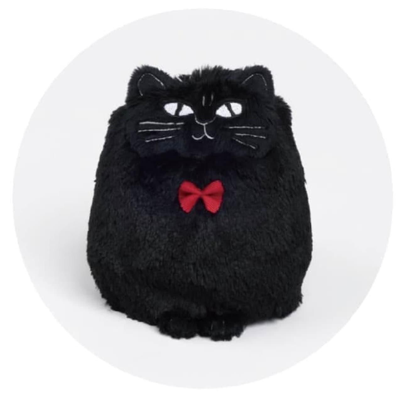 リサ・ラーソンの黒猫「くろごまさん」がアイシングクッキーに -- 赤いリボンがアクセント
